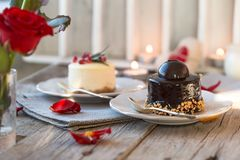 Background for greeting card Valentine`s holiday. Valentine day`s present, sweet treat.chocolate valentine cake and roses stock photography