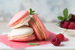 Background for greeting card Valentine`s holiday. Valentine day`s present, sweet treat. Homemade pastel colored macaron cookies, w stock photo