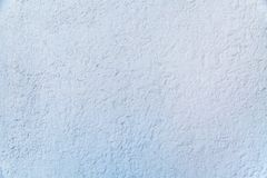 Background of grey painted embossed wall with cracked rough finish. royalty free stock photos
