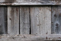Background with grey planks. Old wooden vertical planks with horizontal slats Royalty Free Stock Image