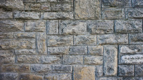 Background of grey stone wall texture Stock Photos