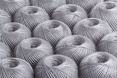 Background grey yarn. Texture of colored yarn skeins stock images