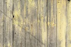 Background from grey and yellow wooden boards with texture. Background from grey and yellow old wooden boards with texture Stock Photo