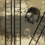 Background with Grunge Filmstrip. And skull in brown Stock Image