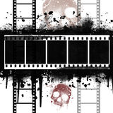 Background with Grunge Filmstrip. And skull in brown Stock Images