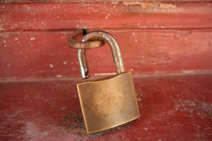 Background: grunge master key hangs on iron hook Stock Photography