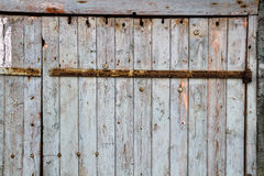 Background with grunge old wooden wall with flaking paint with space for text. Stock Photo