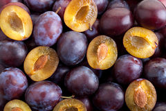 Background of the half and the whole plums Stock Photography