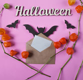 Background. Halloween decoration. Envelope with empty paper for text. Papercut bats flying. Top view with copy space Stock Images
