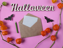 Background. Halloween decoration. Envelope with empty paper for text. Papercut bats flying. Top view with copy space Royalty Free Stock Image