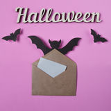 Background. Halloween decoration. Envelope with empty paper for text. Papercut bats flying. Top view with copy space Stock Image