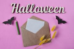 Background. Halloween decoration. Envelope with empty paper for text. Papercut bats flying. Top view with copy space Stock Photography