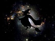 Background for Halloween. Witch on broomstick in the night sky Royalty Free Stock Photo