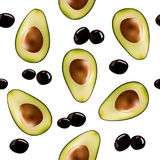 Background with halves of avocado and olives. Stock Photo