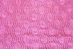 Background from hand-knitted pink fabric Stock Photos
