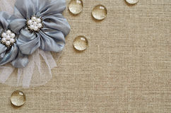 Background with hand-made flowers in the corner. Canvas background with handmade flowers in the corner Royalty Free Stock Photography
