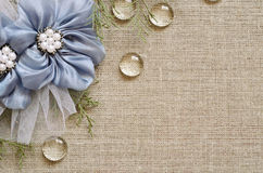 Background with hand-made flowers in the corner. Canvas background with handmade flowers in the corner Stock Photo