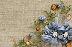 Background with handmade flowers arrangement. Background with handmade flowers and thuja branches on canvas Royalty Free Stock Photos