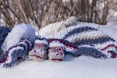 Background with handmade knitted baby booties. Of warm wool in winter sunlight Stock Image