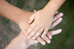 Background of hands of asian female adult and two kids. Group together for support Royalty Free Stock Photo