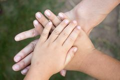 Background of hands of asian female adult and two kids group. Together for support Royalty Free Stock Images