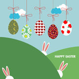 Background with hanging eggs, rabbits and landscape Stock Image
