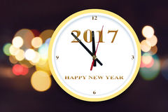 Background of Happy New Year timing countdown concept. Background of Happy New Year 2017 timing countdown concept with colourful night bokeh royalty free stock images
