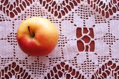 Background for a healthy diet. Healthy eating concept. Apple on a table on a patterned tablecloth. royalty free stock photo