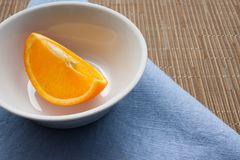Background for a healthy diet. Healthy eating concept. Orange fruit on a table on a blue tablecloth. stock photos