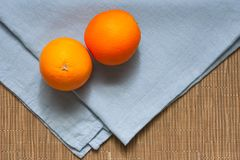 Background for a healthy diet. Healthy eating concept. Orange fruit on a table on a blue tablecloth. royalty free stock image
