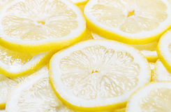 Background of heap fresh yellow lemon slices Stock Image