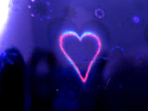 Background Heart. A beautiful heart on shining blue background Royalty Free Stock Image