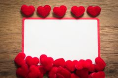 Background with heart on brown wooden floor, blank space for greeting message. Use in Valentine`s Day background concept stock image