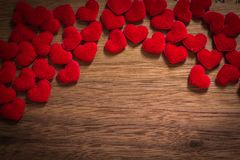 Background with heart on brown wooden floor, blank space for greeting message. Use in Valentine`s Day background concept.  Stock Photography
