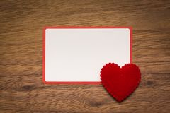 Background with heart on brown wooden floor, blank space for greeting message. Use in Valentine`s Day background concept royalty free stock photos