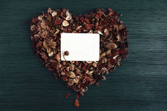 Background with heart from dry fragrant flowers and an empty photograph Royalty Free Stock Image