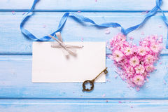 Background  with  heart from  pink sakura  flowers, key and empt Royalty Free Stock Photo