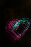Background with heart-shaped lights Stock Images