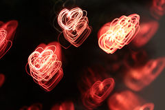Background with heart-shaped lights Stock Photography