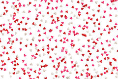 Background of heart sprinkles in red, pink and white Royalty Free Stock Photos
