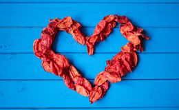 Background with heartshape of sun dried tomato slices Royalty Free Stock Photo