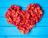 Background with heartshape of sun dried tomato slices Royalty Free Stock Images