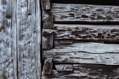 Background of heavily weathered hand chiseled beams and notched. Joints, horizontal aspect royalty free stock photography