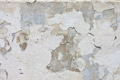 Stone wall with chipped plaster Stock Photography