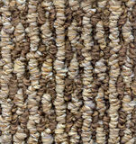 Background high resolution carpet. High resolution background shows all the detail in this carpet sample in colors of brown, brown, tan and white royalty free stock image