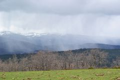 Snow-covered field in the background of high winter mountains. s royalty free stock photography
