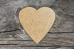 Background with a hole in the shape of heart and old wood board. Background with a hole in the shape of heart Stock Photos
