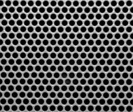 Background with holes. Pattern of the gray metallic background with holes Stock Images