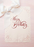 Background Holiday card with text Happy Birthday. Calligraphy lettering Stock Photography