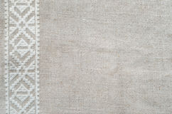 Background of the homespun cloth with white embroidery Royalty Free Stock Images